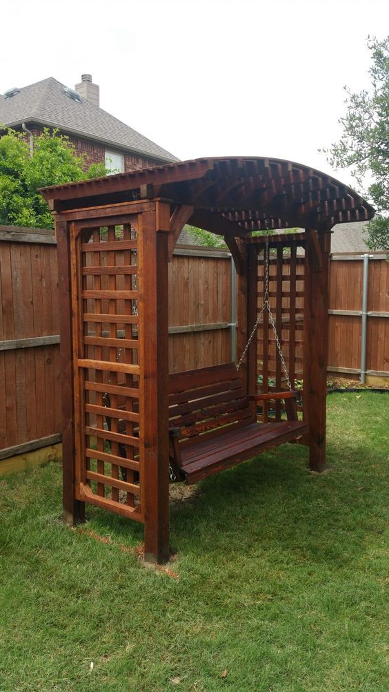 wood arbor swing in a Japanese design #arbor #backyardLandscaping #backyardLandscapingIdeas #landscaping #cheapLandscapingIdeas #backyard #landscaping #pergola