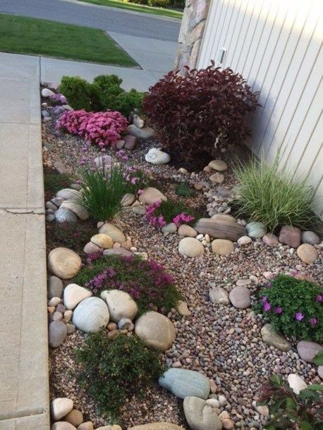 rocks in different sizes and pebbles to cover the garden ground  #flowers #garden #flowerbeds #Hardscaping #mulch #rocks #backyardLandscaping #backyardLandscapingIdeas #landscaping #cheapLandscapingIdeas #backyard #landscaping #curbAppeal