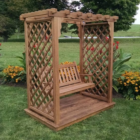 Wood arbor design with a deck and swing #arbor #backyardLandscaping #backyardLandscapingIdeas #landscaping #cheapLandscapingIdeas #backyard #landscaping #pergola