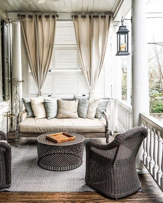 grey themed patio with curtain enclosure  #patioideas #patiodeck #outdoorSpace #outdoordecor #patiodecor #patio #outdoorliving #outdoorFurniture#outdoorCurtains #patioshade