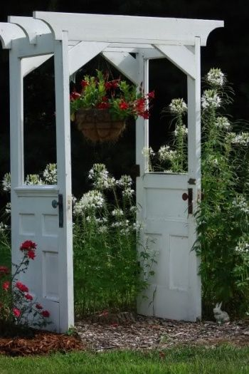 white door recycled into a garden arbor #arbor #backyardLandscaping #backyardLandscapingIdeas #landscaping #cheapLandscapingIdeas #backyard #landscaping #pergola #flowers