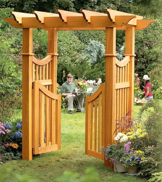 wood arbor with a door design  #arbor #backyardLandscaping #backyardLandscapingIdeas #landscaping #cheapLandscapingIdeas #gate