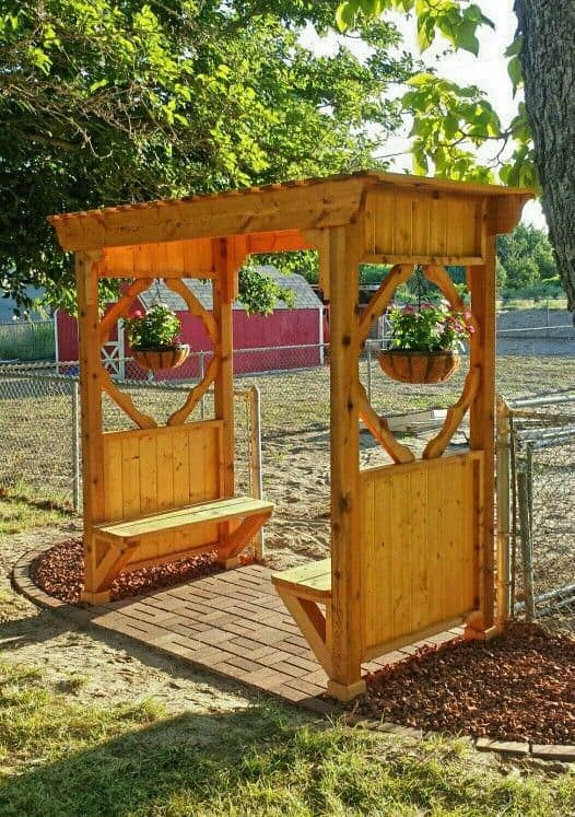 wood arbor with 2 bench seats  #flowers #pergola  #arbor #backyardLandscaping #backyardLandscapingIdeas #landscaping #cheapLandscapingIdeas
