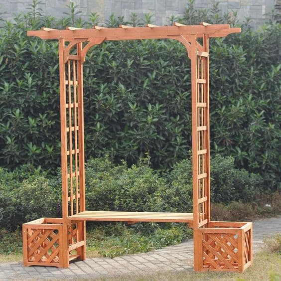 wood arbor with  built-in bench seat and two areas for flower pots  #arbor #backyardLandscaping #backyardLandscapingIdeas #landscaping #cheapLandscapingIdeas