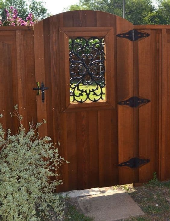 fancy metal hinges on the side of your gate or a decorative metal design in your gate window #fenceGate #fence #gardenfence #gardenfenceideas #privacyfenceideas #privacyfence #backyardLandscaping #backyardLandscapingIdeas #landscaping #gardenfence #gardenfenceideas #privacyfenceideas