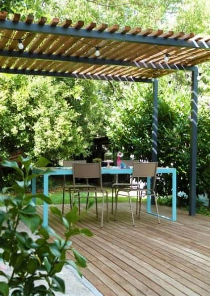 wooden bars are symmetrically arranged as a pergola cover #pergola #backyardLandscaping #backyardLandscapingIdeas #landscaping #cheapLandscapingIdeas #landscape #pavilion #curbAppeal #outdoorliving #outdoorShade