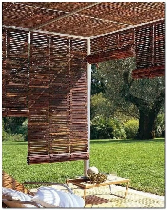 folding bamboo sheets as a pergola cover #pergola #backyardLandscaping #backyardLandscapingIdeas #landscaping #cheapLandscapingIdeas #landscape #pavilion #curbAppeal #outdoorliving #outdoorShade