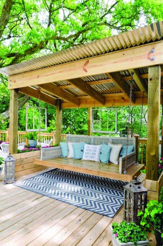 preppy pergola cover uses a corrugated roof #pergola #backyardLandscaping #backyardLandscapingIdeas #landscaping #cheapLandscapingIdeas #landscape #pavilion #curbAppeal #outdoorliving #outdoorShade