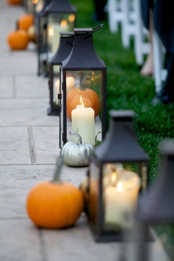 pumpkin and candles on the pathway sides #walkway #pathway #fall #autumn #garden #backyardLandscaping #backyardLandscapingIdeas #landscaping #cheapLandscapingIdeas #landscape #outdoorSpace #backyard #backyardDecor #outdoordecor #backyardLighting #outdoorLights #pathlights #pumpkins