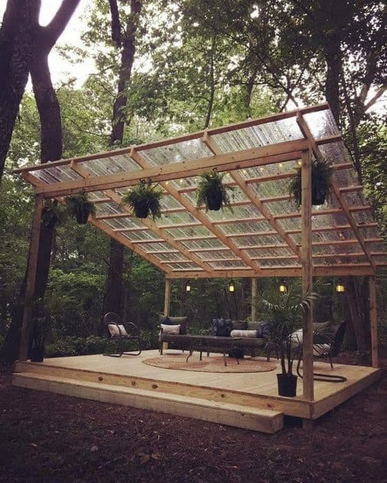 transparent roof pergola in a forest #pergola #backyardLandscaping #backyardLandscapingIdeas #landscaping #cheapLandscapingIdeas #landscape #pavilion #curbAppeal #outdoorliving #outdoorShade