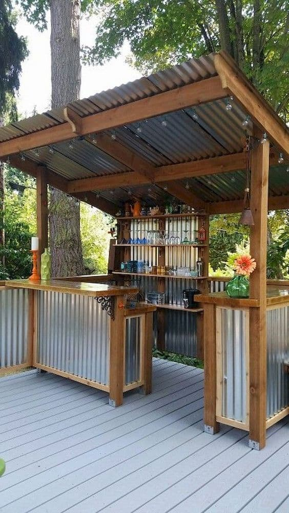 corrugated metal all over your kitchen pergola #pergola #backyardLandscaping #backyardLandscapingIdeas #landscaping #cheapLandscapingIdeas #landscape #pavilion #curbAppeal #outdoorliving #outdoorShade
