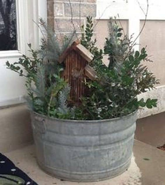 Planter with a birdhouse and greenery #porchIdeas #porch #winter #frontDoorDecor #homeDecor #patiodecor  #Planters