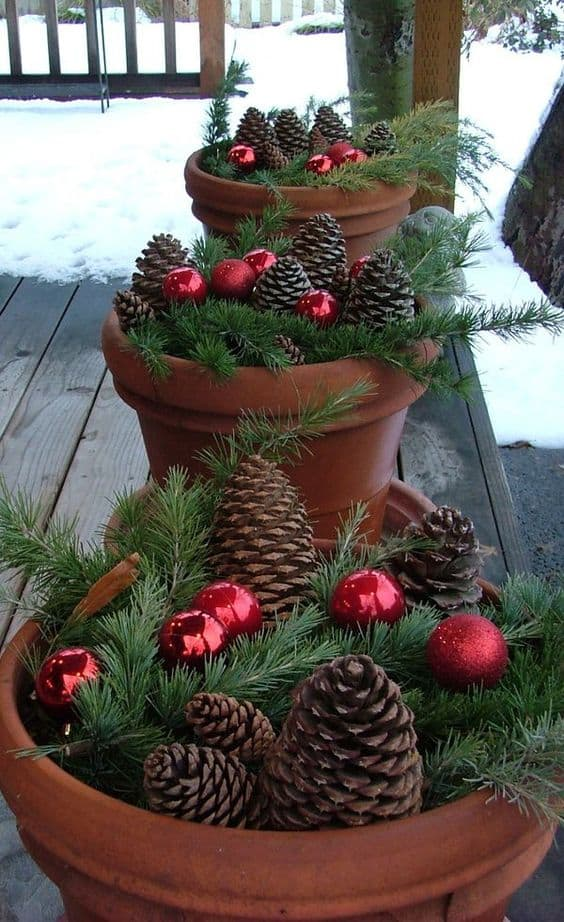planters filled with festive decor and ornaments  #porchIdeas #porch #winter #frontDoorDecor #homeDecor #patiodecor  #Planters