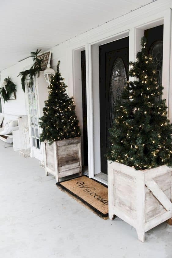 Christmas trees decorated with LED lights  #porchIdeas #porch #winter #frontDoorDecor #homeDecor #patiodecor  #christmasTree