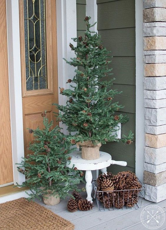 christmas tree decorated with pine cones #porchIdeas #porch #winter #frontDoorDecor #homeDecor #patiodecor  #christmasTree