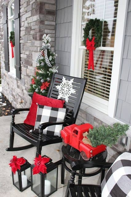 front porch with re themed decoration and some green wreath and Christmas trees #porchIdeas #porch #winter #frontDoorDecor #homeDecor #patiodecor  #christmasTree