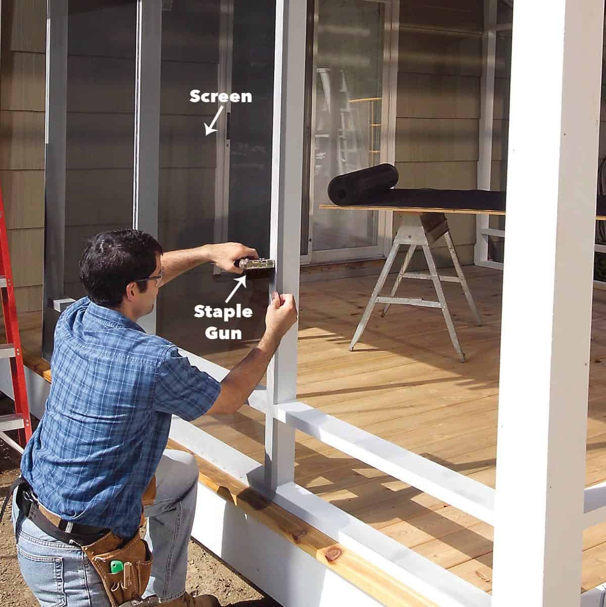 a man installing the porch screen