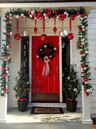 symmetrical design of 2 trees and wreath for a front door #porchIdeas #porch #winter #frontDoorDecor #homeDecor #patiodecor  #christmasTree