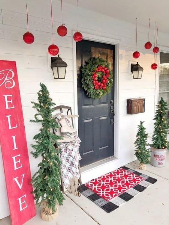 Skinny Christmas trees with LED light  #porchIdeas #porch #winter #frontDoorDecor #homeDecor #patiodecor  #christmasTree