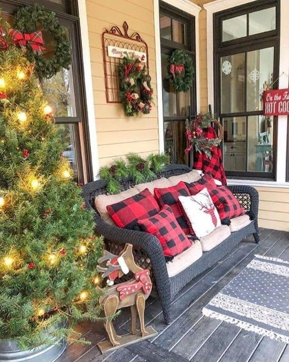 porch decorated with wreath and Christmas trees #porchIdeas #porch #winter #frontDoorDecor #homeDecor #patiodecor  #christmasTree