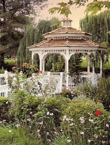 a Victorian gazebo in a blooming garden #gazeboideas #gazebo #pavillion #pavilion #backyardGazebo #flowers
