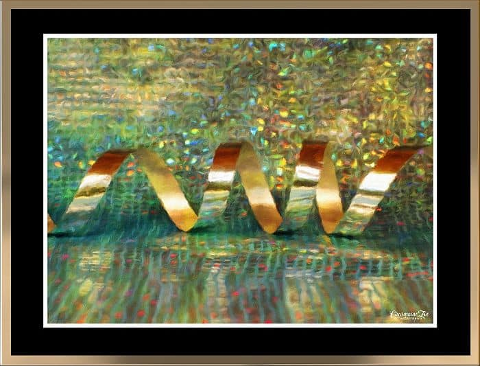 Metallic streamers painting in a framed canvas