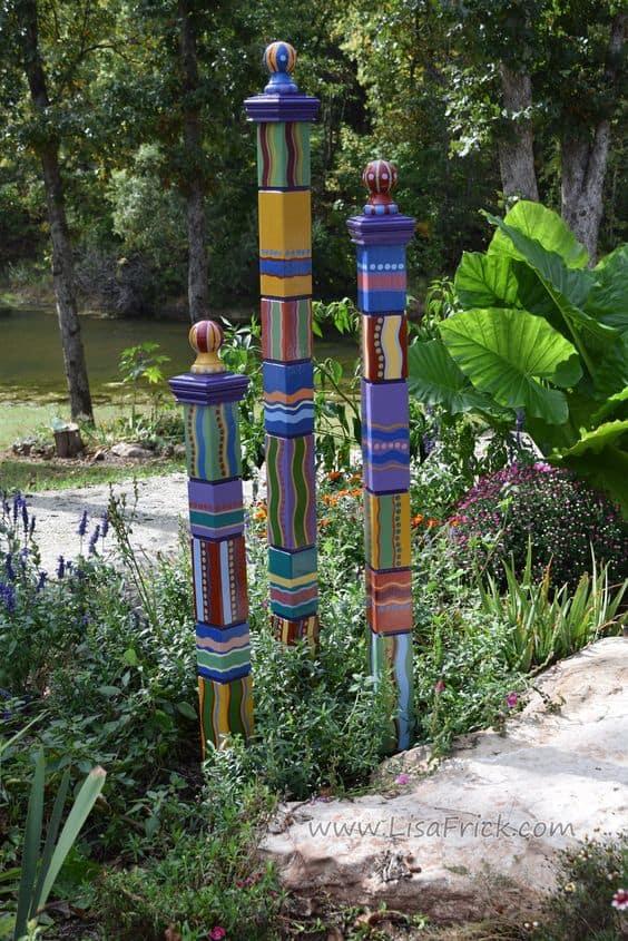 Wooden art sculptures in aform of painted sticks #gardenSculptureIdeas #garden #landscaping #sculpture