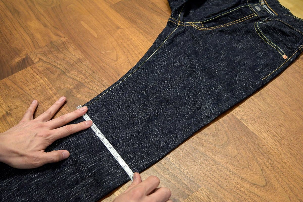 Measuring jeans to be cut