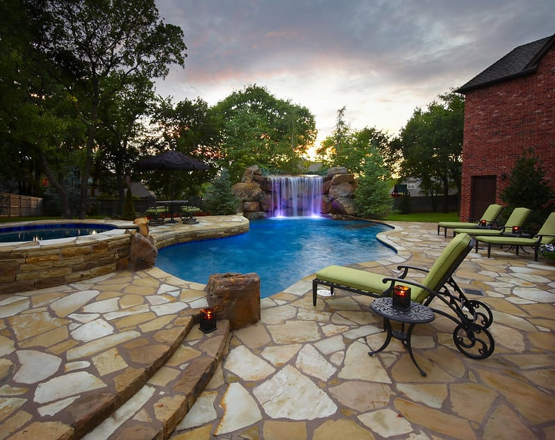Swimming pool surrounded with flagstone flooring