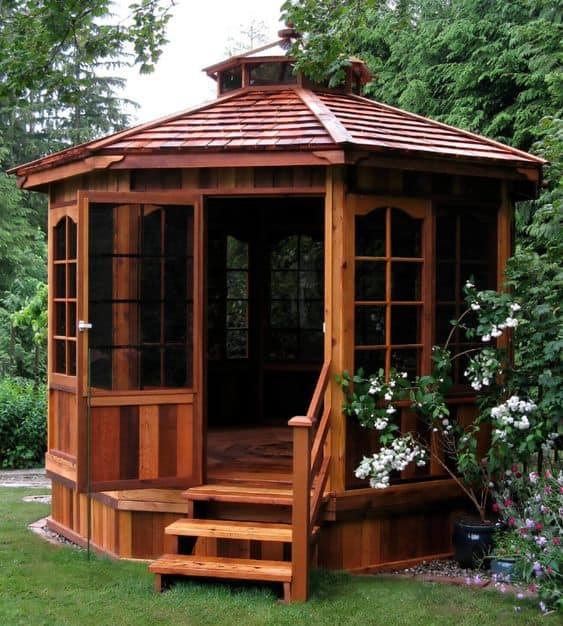 an enclosed wooden gazebo #gazeboideas #gazebo #pavillion #pavilion #backyardGazebo