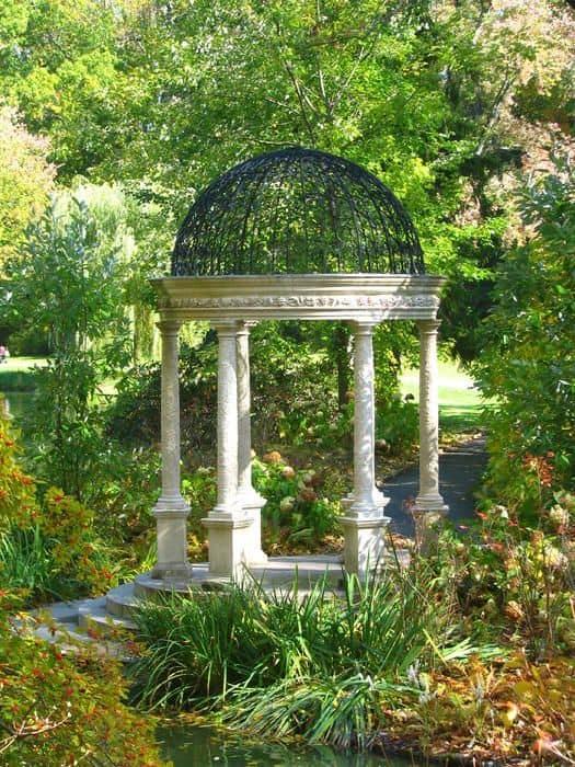 a fancy gazebo in the middle of a garden #gazeboideas #gazebo #pavillion #pavilion #backyardGazebo #garden #plants