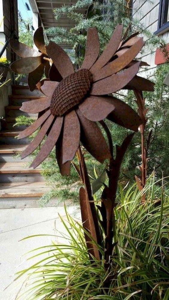 Metal art sculpture in a shape of a flower #gardenSculptureIdeas #garden #landscaping #metal