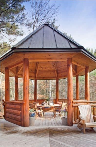 a log gazebo with an outdoor room #gazeboideas #gazebo #pavillion #pavilion #backyardGazebo #outdoorSpace #outdoorRoom