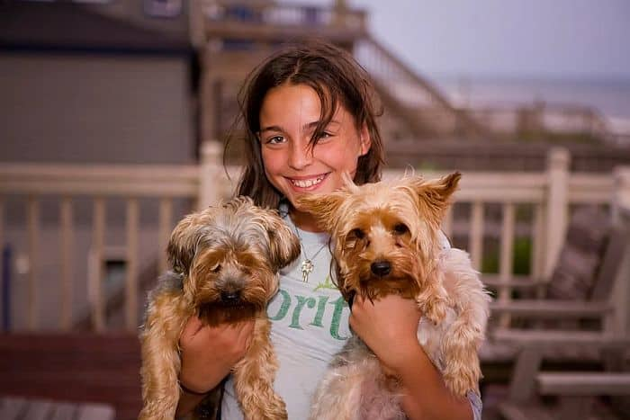 A woman with her pet dogs