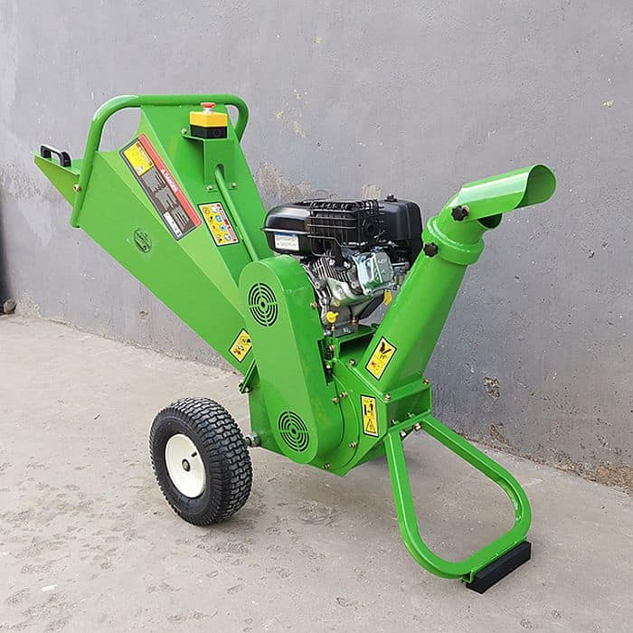 A gas powered wood chipper painted green