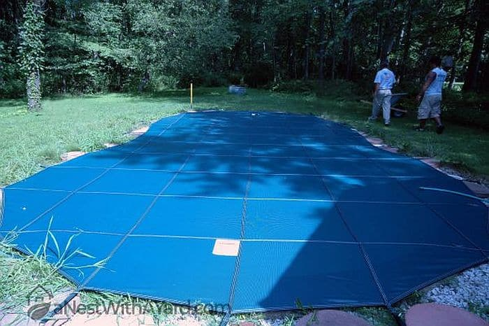 A pool cover correctly installed over a swimming pool