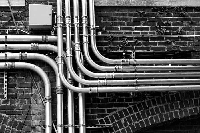 Steel pipes  mounted on the wall outside