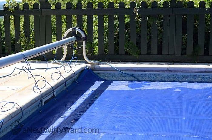 A pool cover unrolled and covering the pool