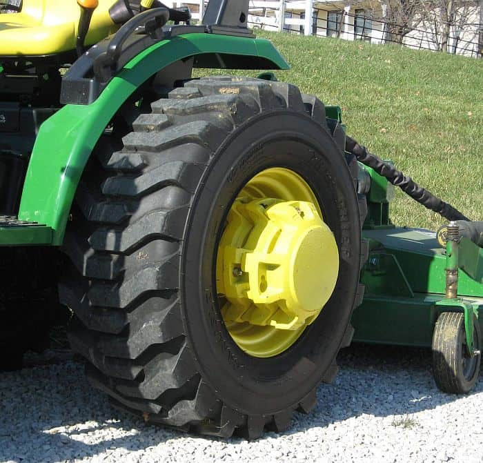Rear end of a tractor with weights on