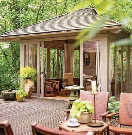 an enclosed gazebo with an outdoor room and curtains #gazeboideas #gazebo #pavillion #pavilion #backyardGazebo #outdoorSpace #outdoorRoom #curtains