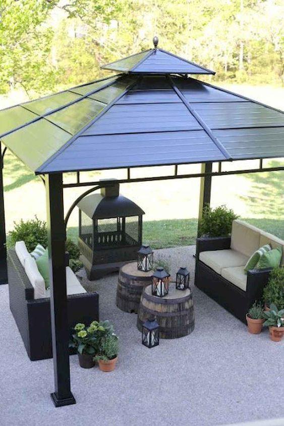 a modern gazebo with a fire pit #gazeboideas #gazebo #pavillion #pavilion #backyardGazebo #BBQgazebo #firePit