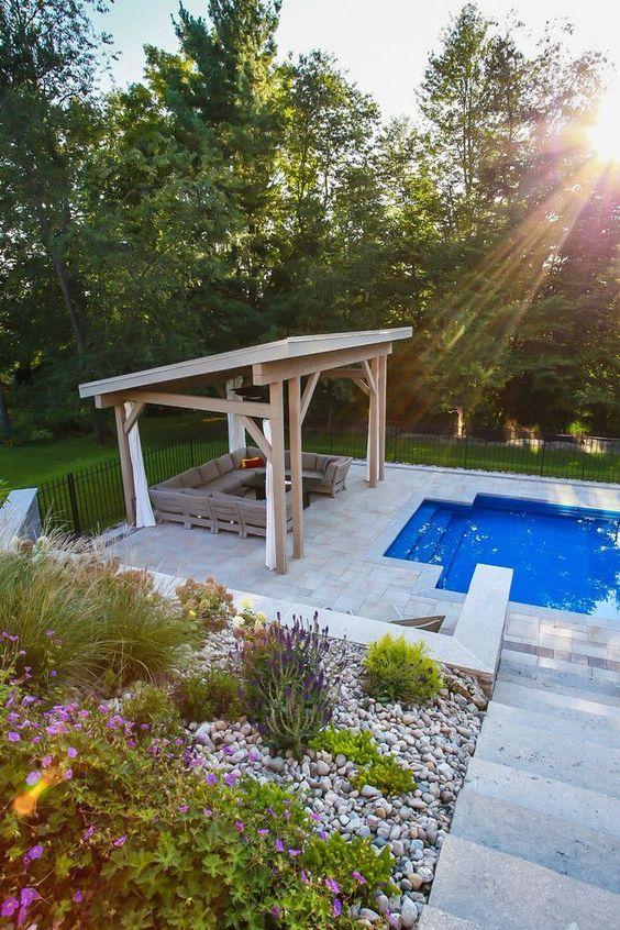 a modern gazebo near a pool #gazeboideas #gazebo #pavillion #pavilion #backyardGazebo #patioFurniture #pool