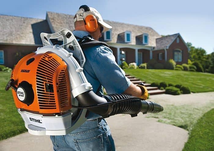 A man using a stihl leaf blower