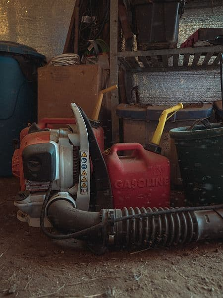 A heavy-duty leaf blower parked in the barn
