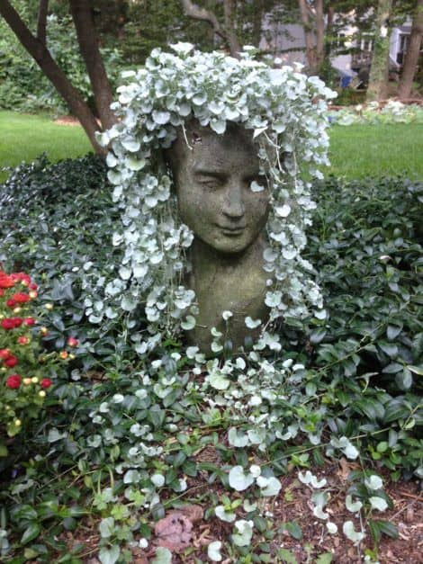 Stone face sculpture #gardenSculptureIdeas #garden #landscaping #sculpture
