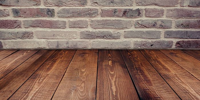 Stained wood floor boards for shed