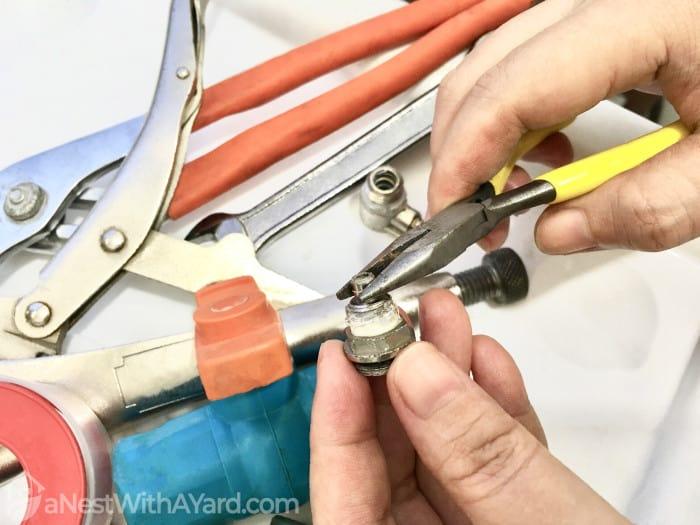 Removing hose bib stem using a couple of tools