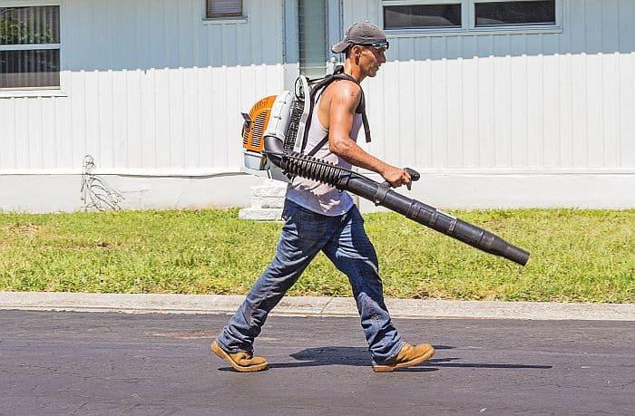 A man operating a stihl back pack leaf blower