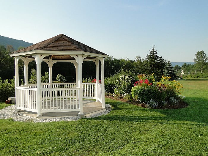 A picture of an octagonal gazebo in grassy lawn