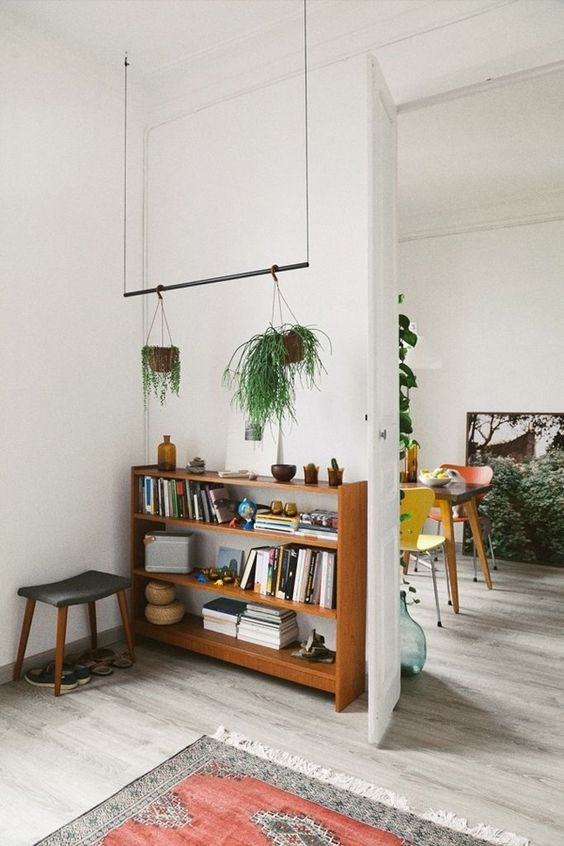 How to hang plants from a ceiling: Hang with thin wires #ceiling #indoorGardenIdeas #indoorgardendesigns #indoorgardenapartment #apartmentindoorgarden #apartmentgardening #plants